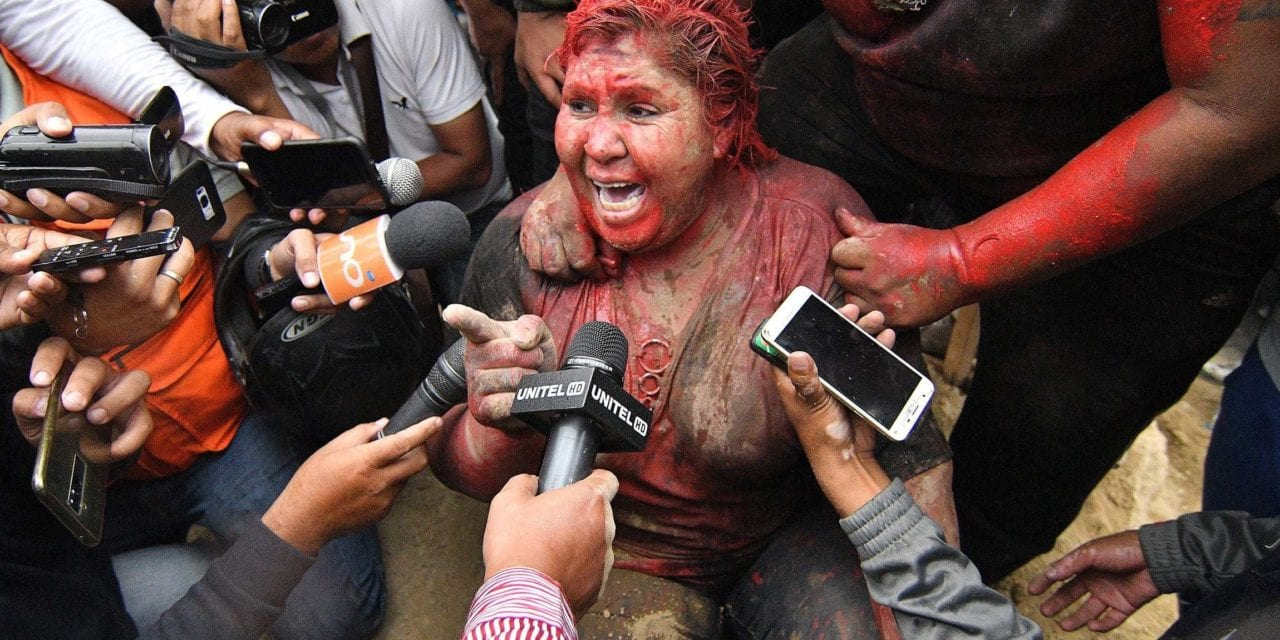 Protesters cut off Bolivian mayor's hair, cover her in paint and drag her through the streets