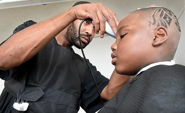 University Avenue barber in St. Paul offers free back-to-school kids' cuts, pandemic-style – Twin Cities
