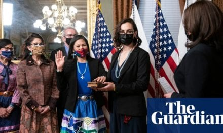 Making history in style: Deb Haaland wears Indigenous dress at swearing-in | Deb Haaland | The Guardian