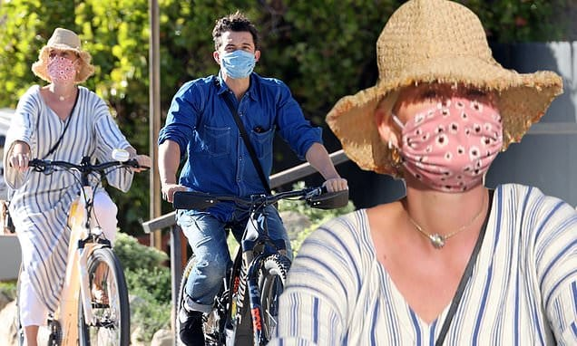 Katy Perry and Orlando Bloom ride in style as they cruise around Santa Barbara on luxury bicycles | Daily Mail Online