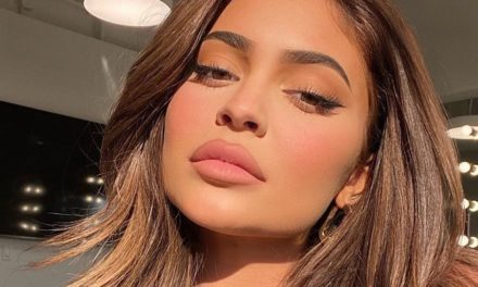 Kylie Jenner Flaunts Her Baby Bump in See-Through Lace Dress at New York Fashion Week